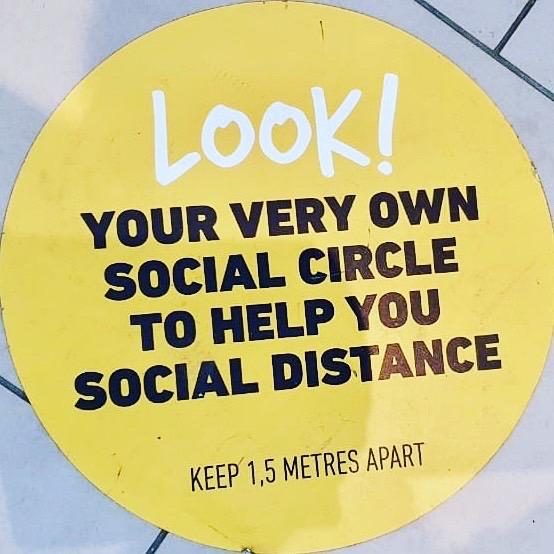 Floor decal that says: Look! Your very own social circle to help you social distance.