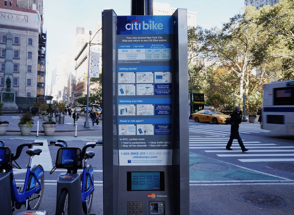Citibike kiosk with infographics used to explain the process
