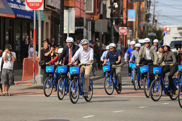 Jersey City, NJ Mayor and his staff using bicycle rentals to demonstrate the desired behavior.